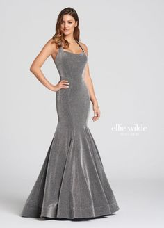 Style EW118101 from Ellie Wilde for Mon Cheri is a formal scoop-neck Novelty Jersey mermaid Prom gown with a halter top and open back.