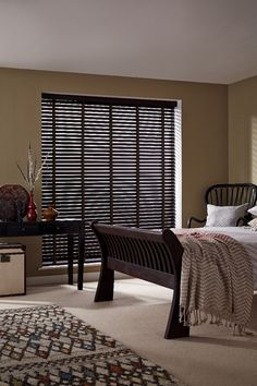 Dark wood and pattern create a cosy global look in a room, plain cream and wool fabrics complete the look well. Made to measure Wimborne Patina wooden blinds and Aztec Dark Natural curtians would work perfectly. Great for bedrooms and livingrooms.