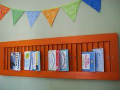 Shutter Display:   Old shutters (or new ones purchased from the hardware store) can be turned sideways to create a book shelf with character!   Something to Do is responsible for this cute idea!