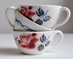 Stacked teacups with red and blue flowers