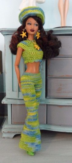 """Hand crocheted outfit for the 11.5"""" belly button Barbie dolls. A funky, 70s retro outfit made from variegated yarn in blue, yellow, and lime green. Handmade Barbie clothes and jewelry only. No doll included. 