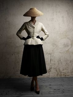 "Inspiration: The Bar suit by Christian Dior. The nipped in waist and wide skirt created what we know as the ""New Look"" post WWII. This stylised silhouette has inspired the design of the Dior VIII watch. Photo-Demarchelier"