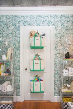 20 Ways to Keep Kid Stuff Organized: Hanging canvas bags keep things tidy from room to car