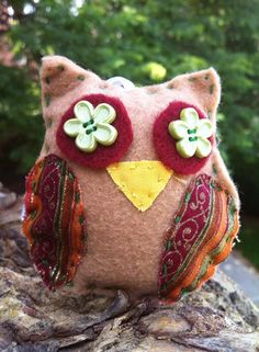 This owl has a silk loop and can be hung as a holiday ornament on a Christmas tree or rear-view mirror.