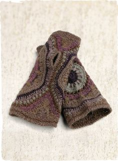 The adorable cold-weather accessory, handcrocheted in concentric circles of plum, mauve, grey and soft blue; baby alpaca (42%), alpaca (25%), pima (25%), bamboo (6%) and silk (2%). Coordinates with our Nazca Alpaca Hat.