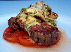 Pan-roasted grass-fed filet mignon, asparagus tips, shiitake mushrooms, heirloom tomato and sauce béarnaise..