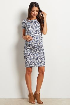 With a simply stunning floral print, this fitted maternity dress will be your new go-to this year as a transitional mom. Dress for any occasion, day or night, with this chic ensemble. This dress will keep any mom comfortable for work or play and can be dressed up with a statement necklace and heels for a stunning ensemble.