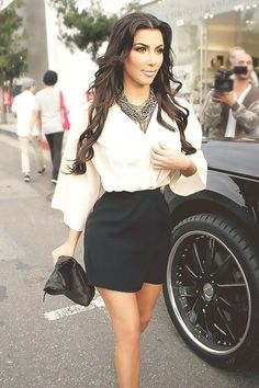 Kim Kardashian -- statement necklace, high-waisted black skirt, filled out top. Good look for pears.