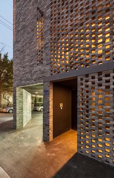 perforated facade - semitranscellurar by skipping the bricks The Beyond the Screen project by OBBA (Office for Beyond Boundaries Architecture) is located on a corner plot in the Naebalsan-dong neighbourhood of Seoul. Brick Design, Facade Design, Exterior Design, Patio Design, Brick Cladding, Brickwork, Architecture Design, Building Architecture, Landscape Architecture