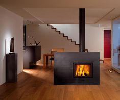 the x-board is a contemporary wood fireplace from attika that would convey style and substance in any home. Wood Burner Fireplace, Fireplace Pictures, Freestanding Fireplace, Fireplace Design, Fireplace Ideas, Great Rooms, New Homes, House Design, Interior Design