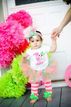 First Birthday Tutu Outfit  -- Pretty Owl -- chevron pinks and greens bow, leg warmers, tutu and personalized onesie. $84.95, via Etsy.