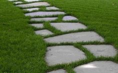 Garden Path: Lay the stones out in the desired pattern, using a shovel to outline where the grass will need to be removed. Move the stones, remove the grass and insert the stones in place.