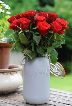 Add a floral touch to your home with a painted Kilner jar and a fresh bunch of roses.