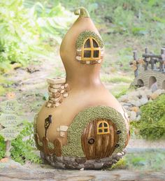 Miniature Fairy Garden Gourd Home is a charming, natural accent for your miniature garden or fairy garden. Has a found look that fits perfectly in any design. Delightfully detailed with windows, door, chimney, rock foundation, lamppost and more. Your fairies will love it!