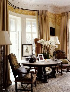 Love this room, esp the curved windows! The ochre hand-painted frieze was used to create another layer of richness in a historically significant London house with elaborate original plaster moldings and ceilings. Designer Robert Couturier brought in artist Paulin Paris for the decoration. Browsing that site can be worthwhile as a source for additional ideas for walls and more.