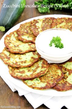 These Zucchini Pancakes Recipe (Video) are golden and crisp on the outside and soft and moist on the inside. Addition of fresh garlic adds a savory kick. A Food, Good Food, Yummy Food, Delicious Recipes, Amazing Recipes, Vegan Recipes, Pancakes Recipe Video, Zucchini Pancakes, Planning Budget