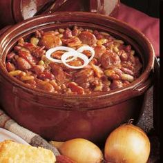 Campfire Beans Recipe. A campfire cookout isn't complete without a side of delicious baked beans. You can even make it at home — we won't tell! Dutch Oven Recipes, Baked Bean Recipes, Crockpot Recipes, Cooking Recipes, Camping Meals, Home Recipes, Tasty Dishes, Cookout Food, Taste Of Home
