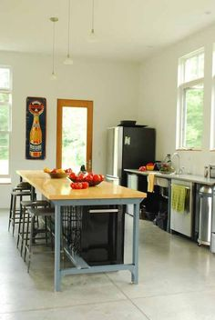 Name: H. Keith Wagner and Sara KatzLocation: North Ferrisburgh, VermontSize: 2200 square feetYears lived in: 8 — owned We've seen several modern farmhouses here on Apartment Therapy. The best of the genre riffs on the traditional vernacular, and so too does this house outside of Burlington, Vermont. Keith Wagner, sculptor and landscape architect, took the landscape as his inspiration and built a house that lives peacefully with its rural surroundings rather than overpowers.