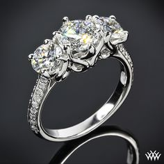 "3 Stone ""Swan"" Diamond Engagement Ring. The graceful lines twist and swirl to create an extraordinary sanctuary for your diamonds"