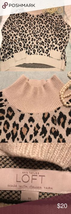 Ann Taylor Loft Gorgeous mock neck sweater I adore this neutral, ultra feminine, mock neck sweater with animal print. Made with Italian yarn... dress it up with your black matchstick denim and some fabulous gold earrings, or down with your distressed denim and a vest. Either way, you're gonna LOVE this sweater. - very gently used and in great condition! Don't forget, if you bundle any two items with me, you automatically save 15%! LOFT Sweaters Cowl & Turtlenecks