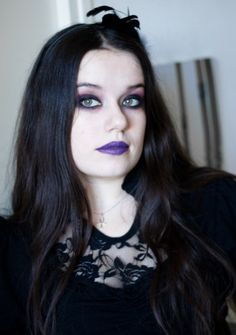 "Blogger of ""Blood is the New Black"" wearing purple lipstick with smoky purple and rose eye makeup."