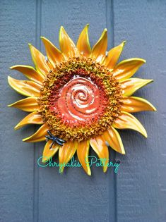 """Sun Whirl"" wall piece for the garden ~ by Chrysalis Pottery The colors and textures are fantastic!"