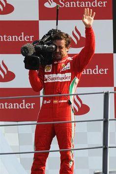 F1 Italian GP - Fernando Alonso (ESP) Ferrari celebrates with a TV camera on the podium.  Formula One World Championship, Rd 13, Italian Grand Prix, Race, Monza, Italy, Sunday, 9 September 2012