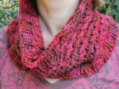 This cozy cowl features yarn carried in front and knitted stitches moving up and down to look like reindeer tracks. A beautiful pattern to show off the colors of variegated yarn.(Stitch IDEAS for freeform sweater. Knitting Terms, Knitting Stitches, Free Knitting, Knitting Ideas, Knitting Projects, Loom Knitting, Crochet Cowl Free Pattern, Knit Or Crochet, Freeform Crochet