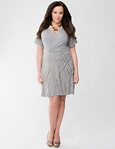 Versatile and eye-catching dress makes its mark with a studded skirt for luxe, Lane Collection style! Short sleeve dress is just right for the warmer days ahead in a wonderfully-soft Jersey that hugs your shape and feels amazing against your skin. Flattering surplice neckline and seamed waist.
