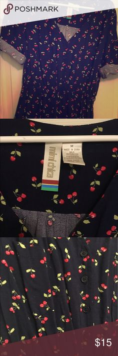 Cherry dress button up shirt dress Button up dark navy blue with cherry print. Lightweight. Never worn. I always buy things that are colorful and they will sit in my closet forever because I only wear black and gray. I thought this dress was so cute. Mimi Chica Dresses