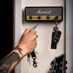 The official licensed Marshall Jack Rack is HERE! Hang your keys like a rockstar with this replica Marshall Amplification Jack Rack. Easy to install, and guaranteed to impress all your friends! JACK RACK COMES WITH: 4 guitar plug keychains engraved with the Marshall M logo 1 wall mounting