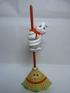 """Hand painted cute Halloween rake with a ceramic ghost on the handle. It is approximately 8"""" tall and 3 1/2"""" wide. This rake comes with a right sided ghost with his eyes open. This goes with the other rake with ghost available separately. Mix or match the rakes with the Halloween cats or other ghost. Halloween Biscuits, Halloween Crochet Patterns, Ceramic Bisque, Pasta Flexible, Kids Corner, Ceramic Decor, Cute Halloween, Hand Painted Ceramics, Clay Crafts"""