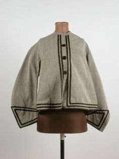 Jacket - Grey alpaca trimmed with narrow black tape, slit in back. Probably altered. 1860 (circa)