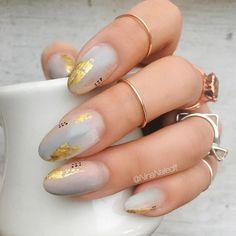 soft pastel nails with gold leaf nail art detail
