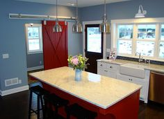 Absolutely adore the red (or white!) rolling barn door.  Love, love, love!