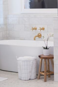 Spa Like Bathroom Features A Wyndham Collection Mermaid X Soaking Bathtub  Placed Under A Gold Wall Mount Tub Filler, Kohler Purist Wall Mount  Non Diverter ...