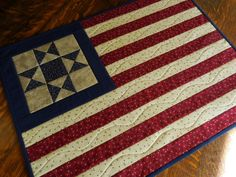 Quilted Patriotic/Flag/ Wall Hanging/Table Topper in country colors of red, blue and cream fabrics by RubysQuiltShop on Etsy