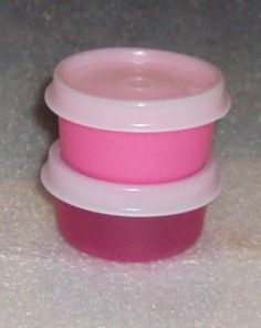 Tupperware Set of 2 Small Bowls SMIDGETS Punch Pink and Fuchsia Pink by Tupperware. $9.99. Set of 2 Tupperware Smidgets in shades of pink.  Tiny Tupperware storage containers.  Great for small quantities.  Make a wonderful pill box, travel containers for creams, lotions, shampoo, conditioner.  Ideal for spices, tiny beads, fish hooks ...fits into purse, pocket, lunch box, brief case, gym bag, take camping or hiking.