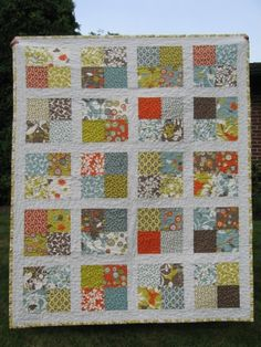 """Very simple and cute.  The back is about two thirds one fabric, broken by a 1-1.5"""" border and another one third of another fabric.  Really like.  http://comeandseetheseitz.com/2009/07/03/baby-boy-quilts/"""