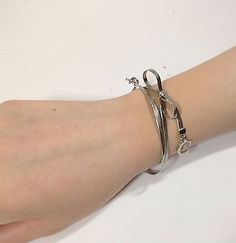 "Authentic Christian Dior Silver Bow ""CD"" Drop Bracelet w/ Box & Ribbon (ES444) - http://designerjewelrygalleria.com/christian-dior/authentic-christian-dior-silver-bow-cd-drop-bracelet-w-box-ribbon-es444/"