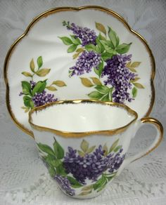 Lovely tea set of purple and gold edges.