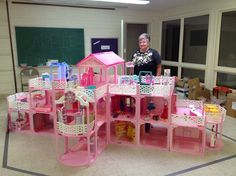 Marcia Ogren of Norton Shores, Michigan has collected Barbies since the 1970's. She set up part of her collection in the fellowship hall of the Church of God United. She assembled this huge Barbie house using snap-together pieces from 16 Barbie house sets from the 1980's.