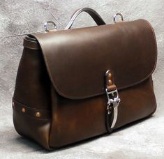 Handcrafted custom brown leather messenger bag inspired by the beautiful leathers from the Horween Tannery in Chicago. The…