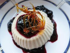 Toasted Coconut Panna Cotta with Blueberry sauce and spun sugar garnish