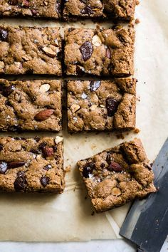 Quick and easy flourless chocolate chunk almond butter cookie bars that are soft and chewy with crunchy dry roasted almonds studded throughout. Almond Butter Snacks, Almond Butter Cookies, Gluten Free Baking, Gluten Free Desserts, Easy Desserts, Brownie Recipes, Cookie Recipes, Dessert Recipes, Bar Recipes