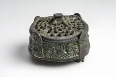Object from the exhibition We call them Vikings produced by The Swedish History Museum - Box shaped brooch with rune carving. Bronze