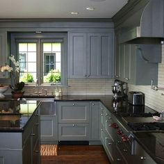 Blue Kitchen Cabinets With Black Countertops - Design photos, ideas and inspiration. Amazing gallery of interior design and decorating ideas of Blue Kitchen Cabinets With Black Countertops in kitchens by elite interior designers. Blue Gray Kitchen Cabinets, Grey Kitchens, Painting Kitchen Cabinets, Kitchen Paint, New Kitchen, Dark Cabinets, Black Granite Kitchen, Kitchen Grey, Dark Kitchen Countertops