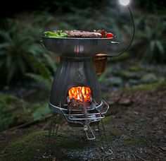 BioLite BaseCamp Stove. BioLite BaseCamp Stove With the flip of a switch, this wood-fired campstove can go from grilling to boiling and features a 5V USB port to charge your devices while you cook plus this powerpack also has a battery for a quick charge whenever you need it, fire or not.