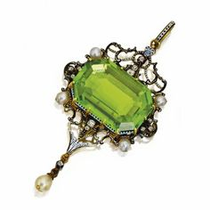 Gold, silver, peridot, diamond, pearl and enamel pendant, Carlo Giuliano, circa 1874-1895. Set in the center with an emerald-cut peridot measuring approximately 22.0 by 15.0 by 6.0 mm., within an openwork frame set with old mine diamonds and pearls, applied with black and white enamel, signed C.G for Carlo Giuliano. With original signed and fitted box, signed C. Giuliano, 115 Piccadilly, London.