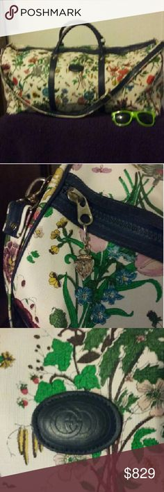 Gucci floral Luggage Bag !! Rare Vtg Treasure #Gucci #RareGucci   Repost: 2nd posting as initial posting offers were way too low. Please do not waste our time, to offer anything less than half my asking price  Authentic Vintage Floral Gucci Duffle With Long strap and Gucci zipper Pulls   Measures approx 22 x 12 x 20   Classic Flora pattern of crickets, butterfly, etc with Navy Blue accent  Exterior -Amazing condition for age Interior -wear, minor blemishes Handles -impeccable   Fair Offers…